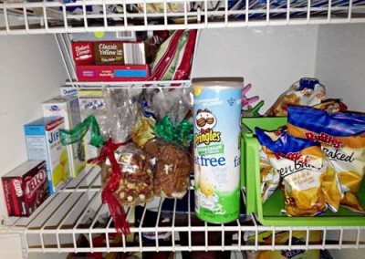 This shelf is full of chips and baking materials. The lonely stackable container here is storing Jan's son's snack bags of chips so they don't get lost with the larger bags. I also found this great storage basket at Roses for 5$! These work great for wire shelves and wood shelves!