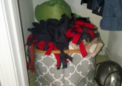 The coat closet floor is now being used for blanket bin storage and mini-vac storage.