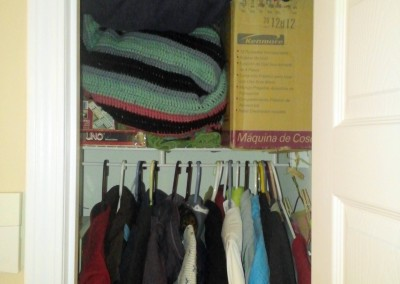 Coat Closet Shelf. Used for storing blankets, a sewing machine, and other miscellaneous items.